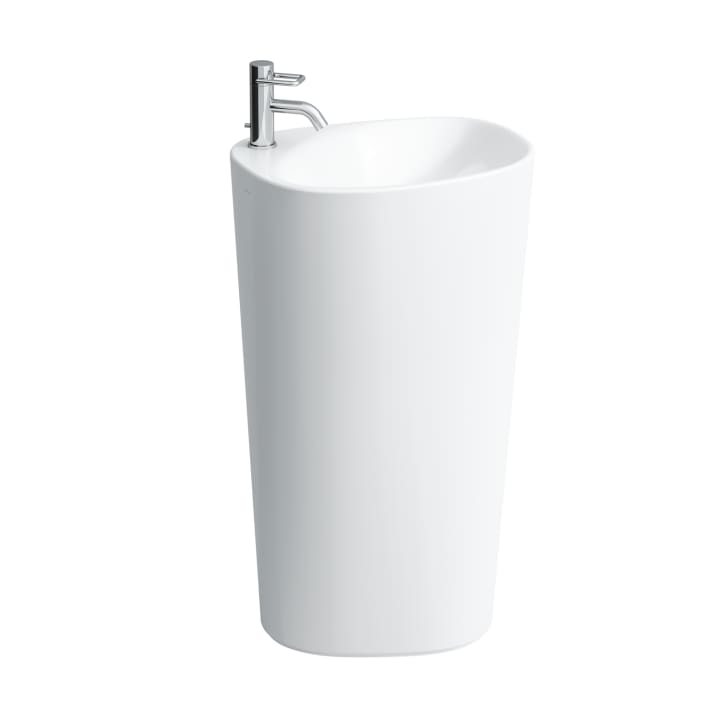 Washbasin with integrated pedestal, with wall connection